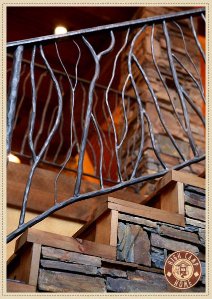 Stair railing; forged iron made to look like tree branches. High Camp Home  Interior