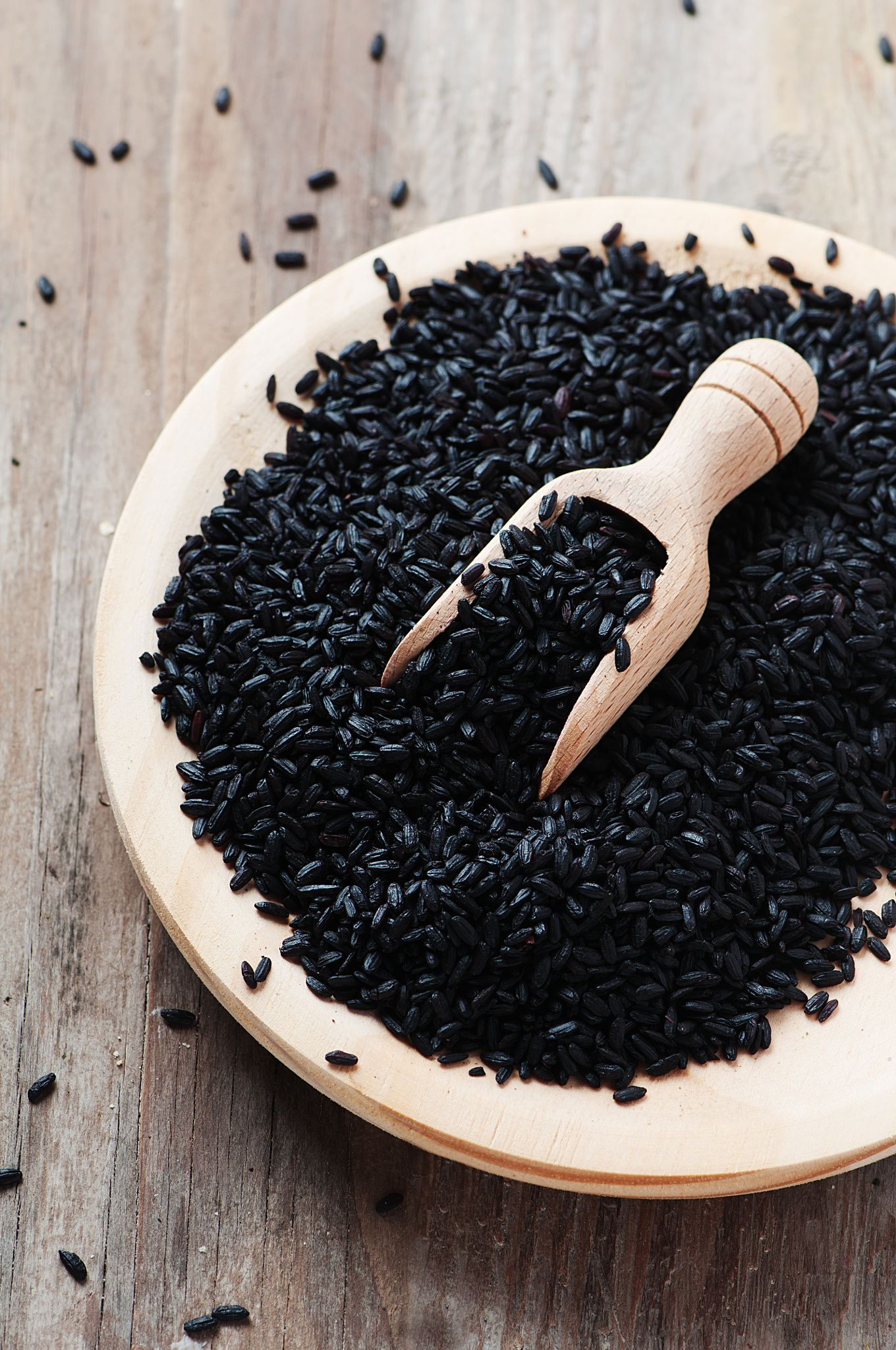 Black uncooked rice on the wooden table by Oxana Denezhkina on 500px