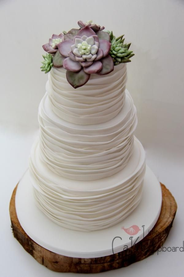 Elegant Wedding Cake With Smooth Style Ruffle Layers And Edible Sugar  Succulents.
