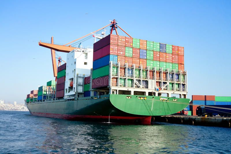 Cargo ship full of containers. Green cargo ship in port