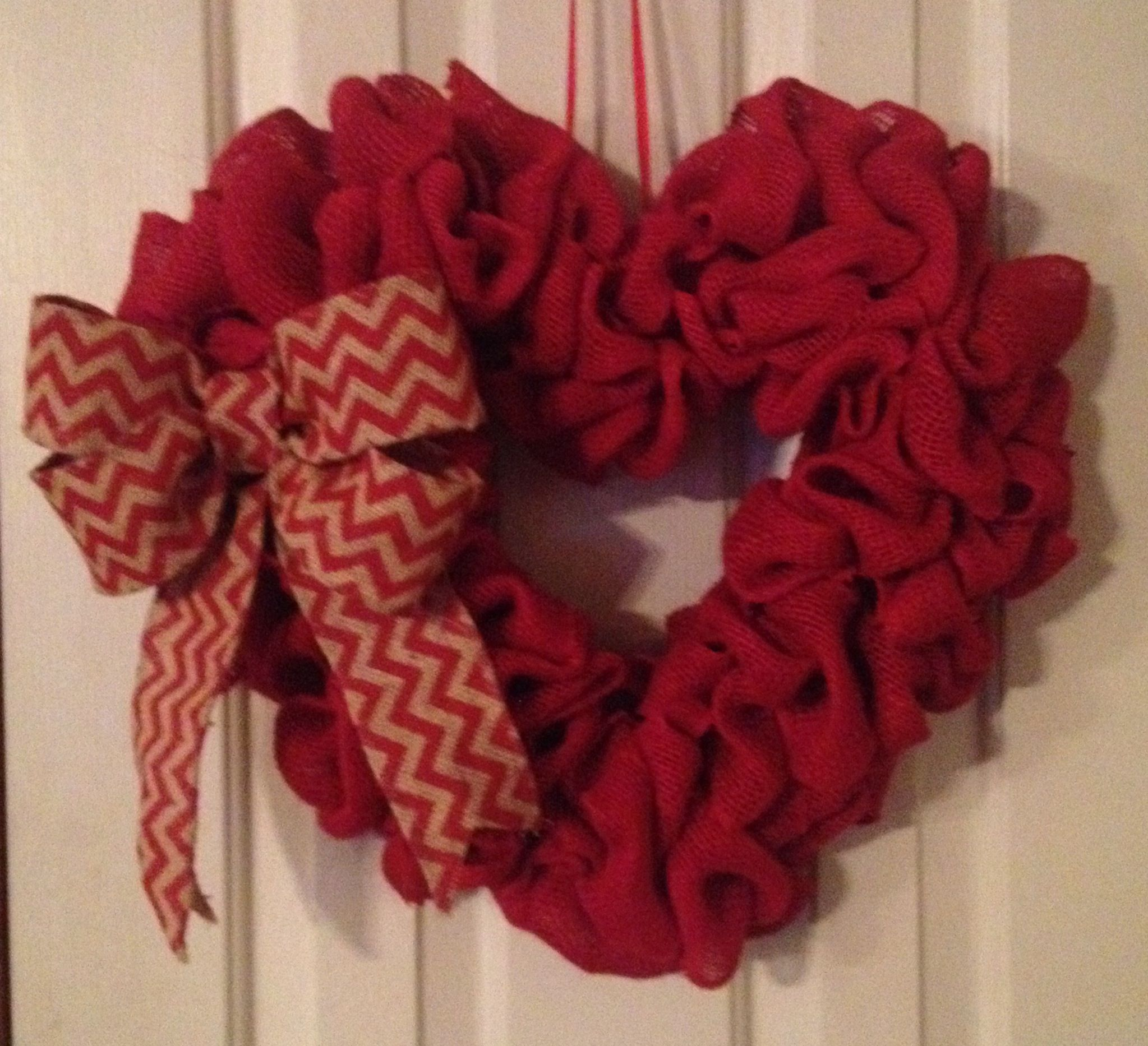 Heart shaped burlap wreath with chevron bow
