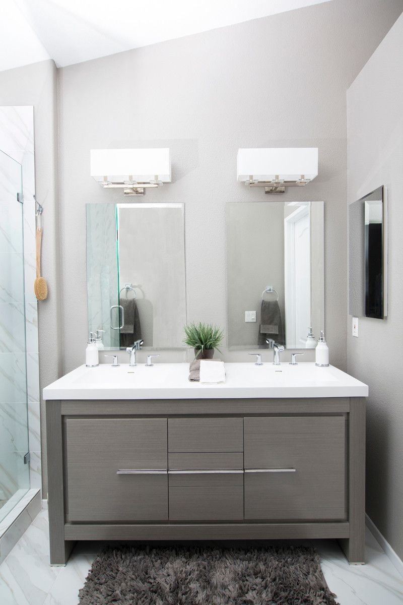 Mid-sized trendy master gray tile, white tile and stone slab marble ...