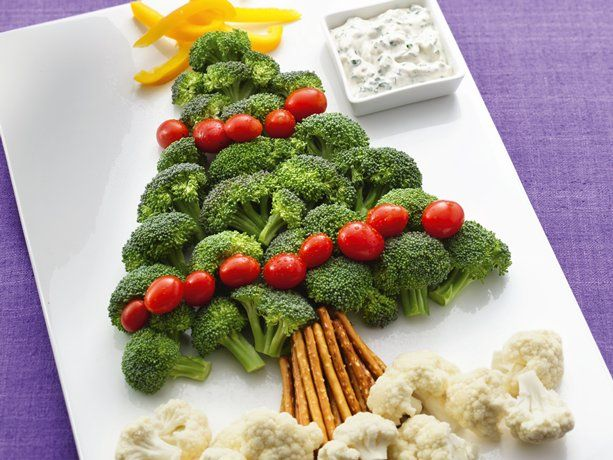 "Christmas Tree Vegetable Platter.  Broccoli & tomato ""tree"" with yellow bell pepper ""star"", pretzel ""trunk"" & cauliflower ""snow"" dippers for cool & creamy herb dip."