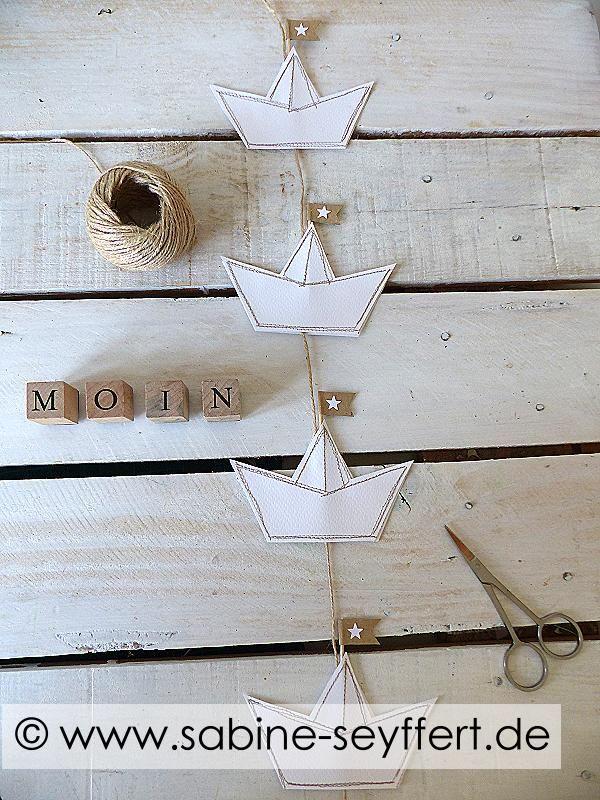Selbst gemachte Sommerdeko: Papierschiff aus Tonkarton nähen – DIY Deko Idee