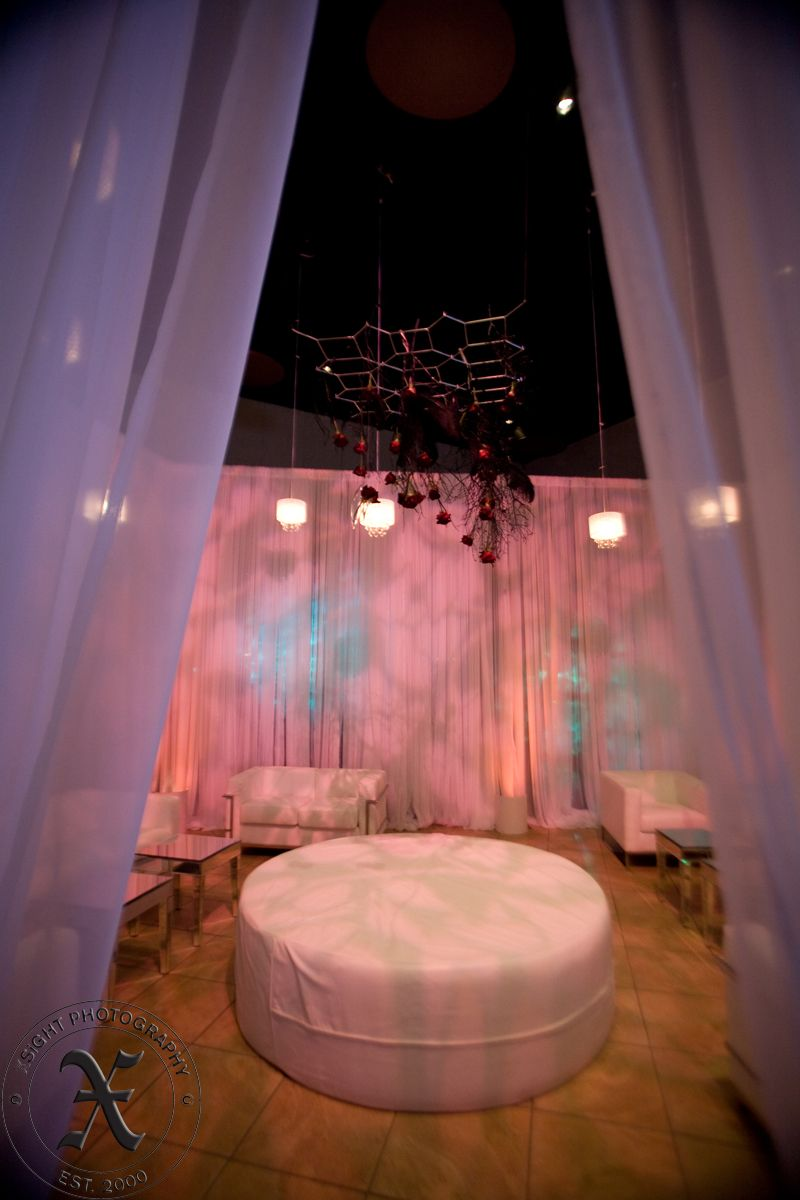 Custom Lounge created with White Chiffon drapery and lighting by Enhanced Lighting