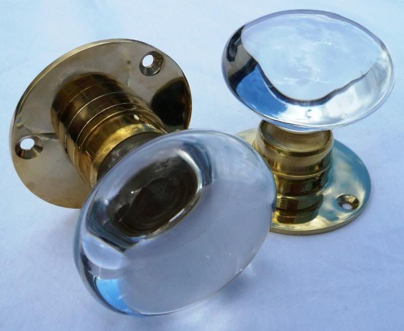 Pair Of Clear Glass Door Knobs On A Smooth Brass Back Plate