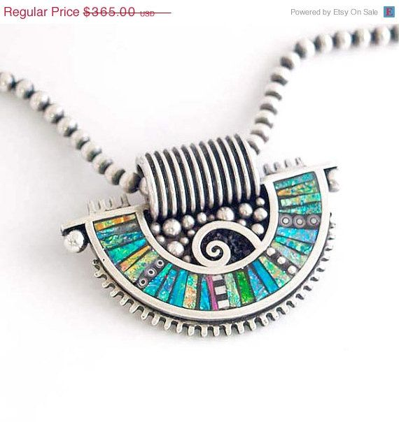 CIJ SALE Silver Fan Shaped Pendant with Iridescent Mosaic Polymer and sterling silver inlay. $310.25, via Etsy.