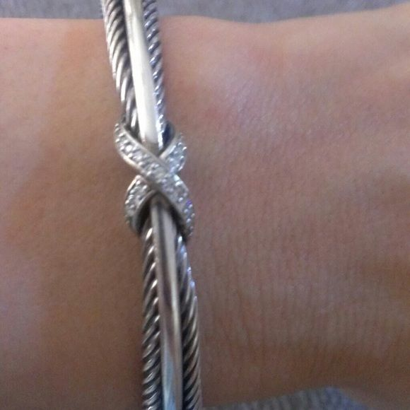 David Yurman X Crossover Cuff Bracelet Beautiful, authentic David Yurman bracelet. Well taken care of. Comes with dust bag. Sterling Silver, pave diamonds (.13 total carat weight). Bracelet is 7mm wide with an interior circumference if 5.5 inches. David Yurman Jewelry Bracelets