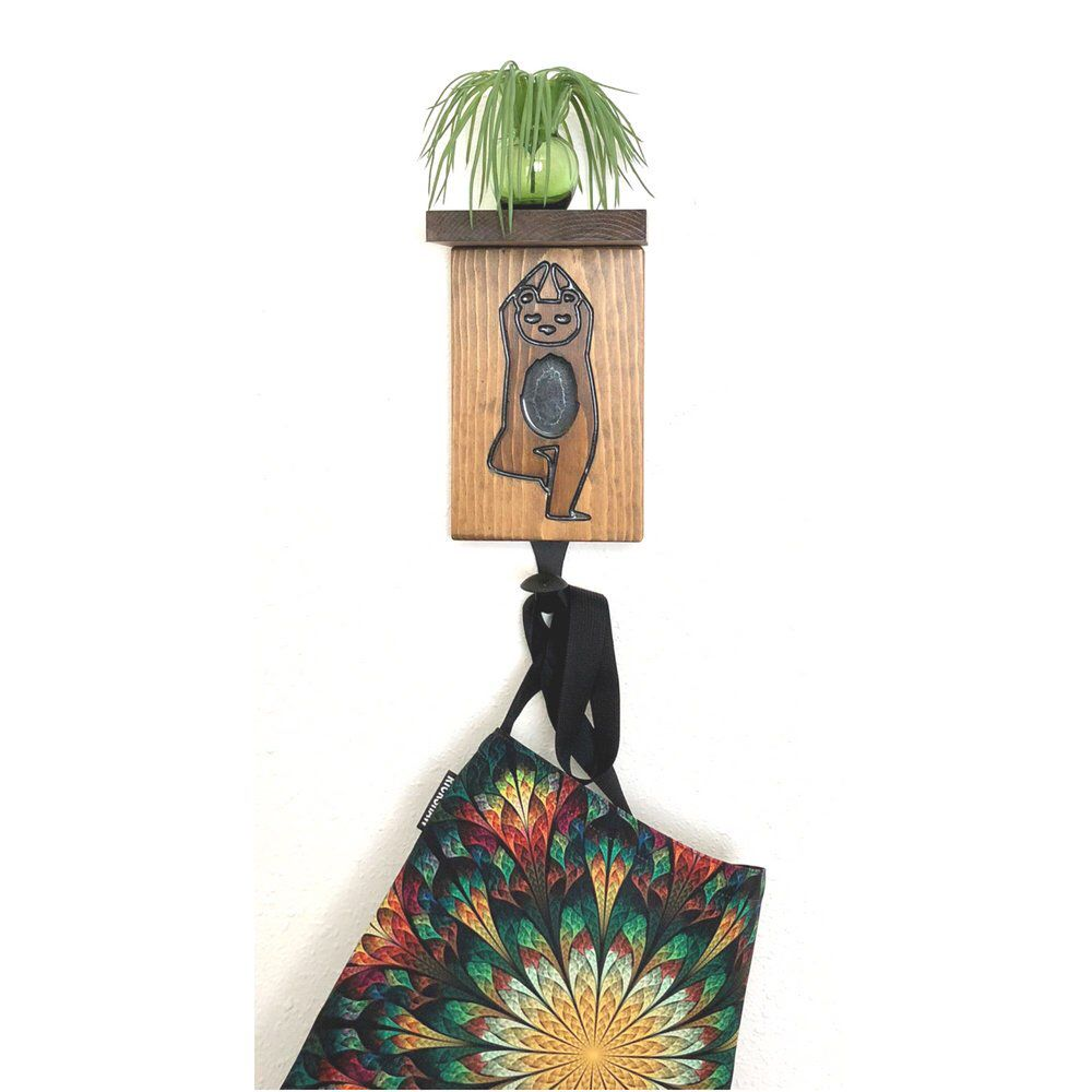 It has a shelf, a carved #yogi bear and a hook. Multipurpose gift R the best! #yoga