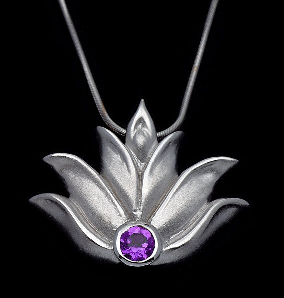 "This lotus flower pendant necklace is sterling silver with an amethyst stone. It has a hidden bail which allows for it to fall simply and beautifully on the neck. It measures approximately 1"" x 1"" and comes with an adjustable 16- 22"" coordinating cable chain. This piece also comes in a 1/2"" size. Please check other listings for details."