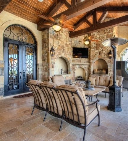 Tuscan Outdoor Living Space With Open Beams Arched Wrought Iron
