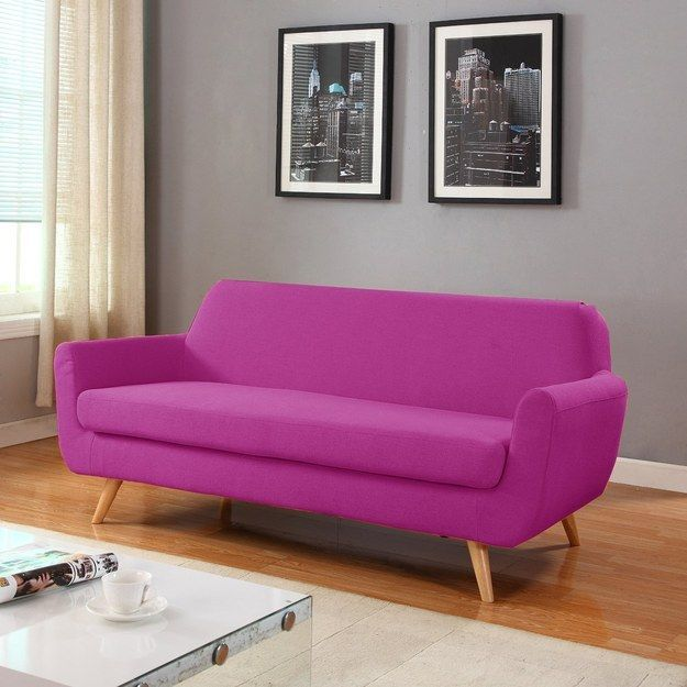 This playful purple couch that adds a pleasant pop of color ...