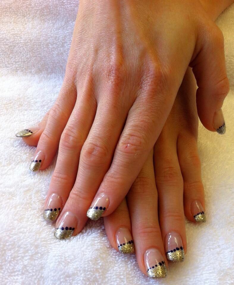Love my new nails, metallic tips and navy spots. http://www.opening ...