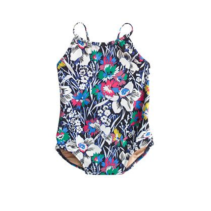 This fully-lined swimsuit is made from the same quick-drying, fade-resistant and perfectly stretchy (read: comfy) fabric we use for our girls' swimsuits. Featuring an exotic floral print from London's Liberty Art Fabrics (it's been famous for its for eye-catching florals and paisleys since 1875), this little swim tank is ready for baby's first trip to the beach—and many more after that. <ul><li>Please note that sizes are measured in months.</li><li>Nylon/spandex.</li><li>Hand ...