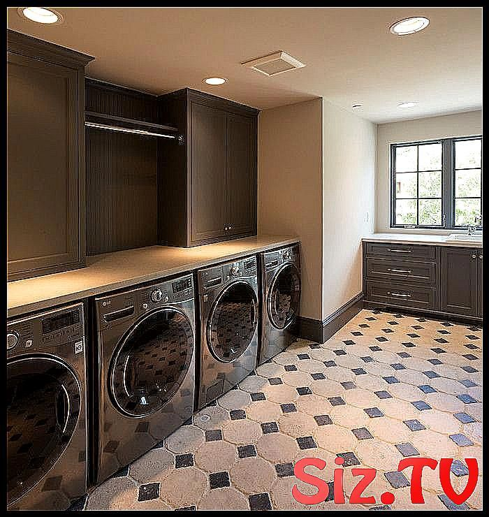 Gray laundry room features two sets of gray front  #atop #Backsplash #beadboard #black #cabinets #countertop #Dark #dryers #features #Floors #front #Gray #laundry #Laundry_Room_design_tension_rods #Load #Rod #room #sets #shaker #stacked #tension #tucked #washers #White #graylaundryrooms Gray laundry room features two sets of gray front  #atop #Backsplash #beadboard #black #cabinets #countertop #Dark #dryers #features #Floors #front #Gray #laundry #Laundry_Room_design_tension_rods #Load #Rod #roo #graylaundryrooms