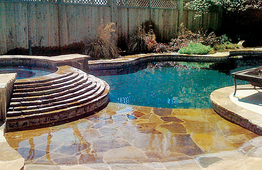 Beach entry tanning ledge stone and pool color dream for Pool design hours