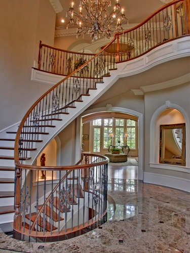 Elegant two story marble foyer with floating staircase for 2 story spiral staircase