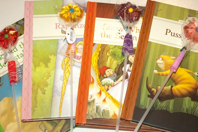 Instead of 'Loot Bags' we gave each party-go-er a gift-wrapped book with a small lollypop attached. Simple and elegant!