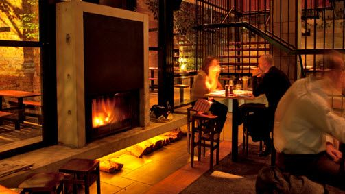 The double sided fireplace can be enjoyed inside or outside.  The Royal Saxon Hotel Prahan, Melbourne