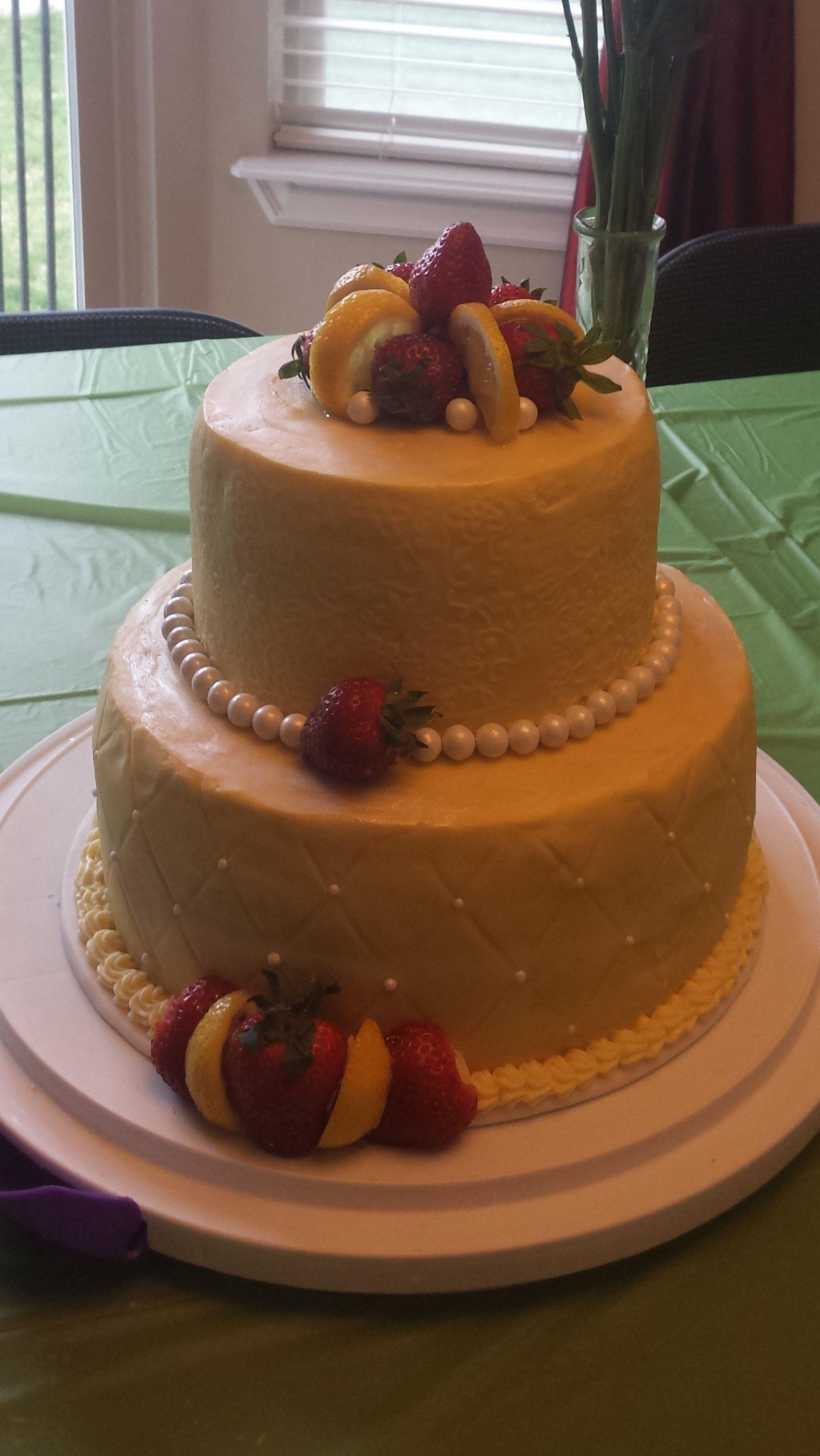 Strawberry lemonade cake with lemon fudge buttercream, lemon cake and strawberry filling
