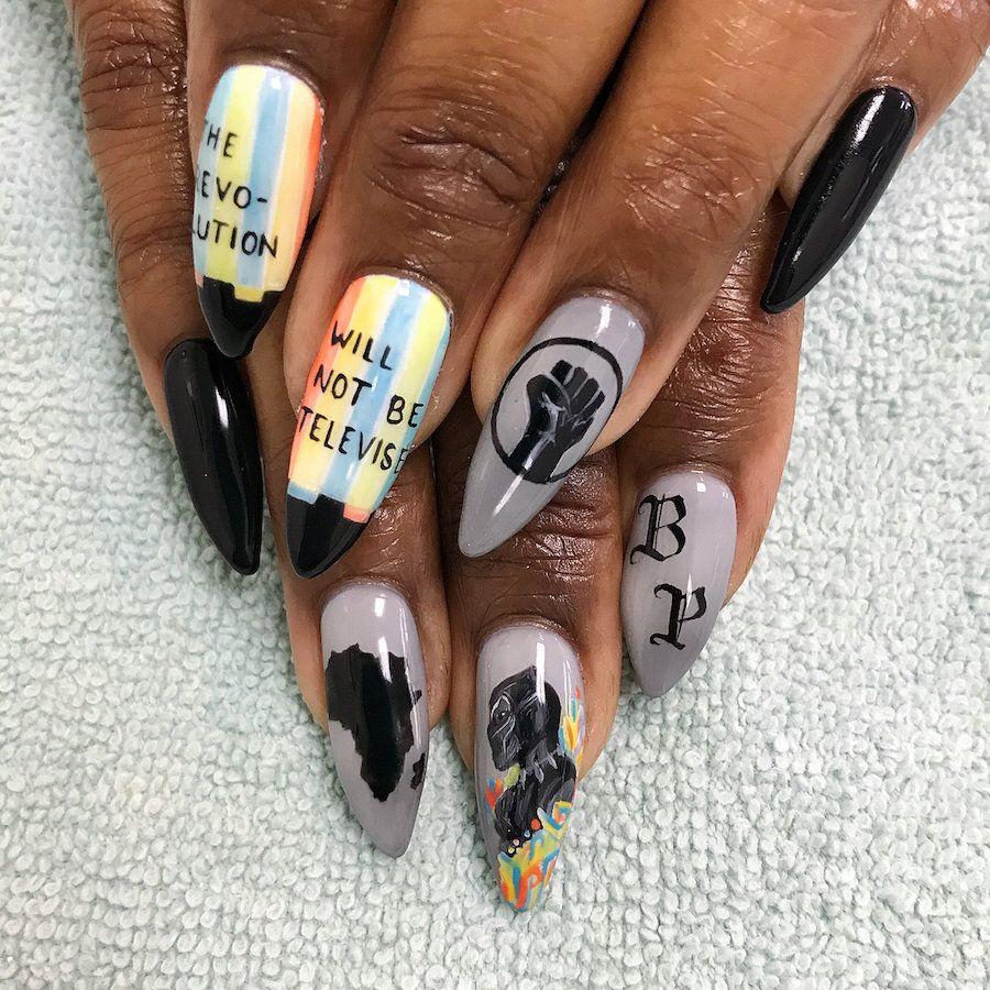 http://www.revelist.com/nails/black-panther- - Some Showed Off Their Panther Fandom In A Sleek, Subtle Way. Nail
