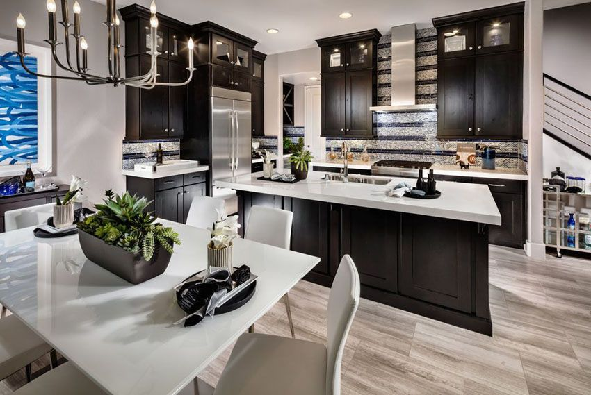 Dark Cabinet Kitchen With White Super Thassos Glass Countertop And