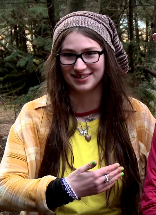 """Rainy borrows my shirts, but when I wear them they reach to here.."" Snowbird, Birdie, from Alaskan Bush People."