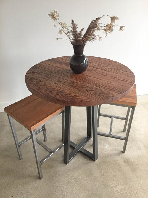 This Round Reclaimed Wood Dining Table Blends Industrial Crossed Legs With  A Smooth Modern Circular Top