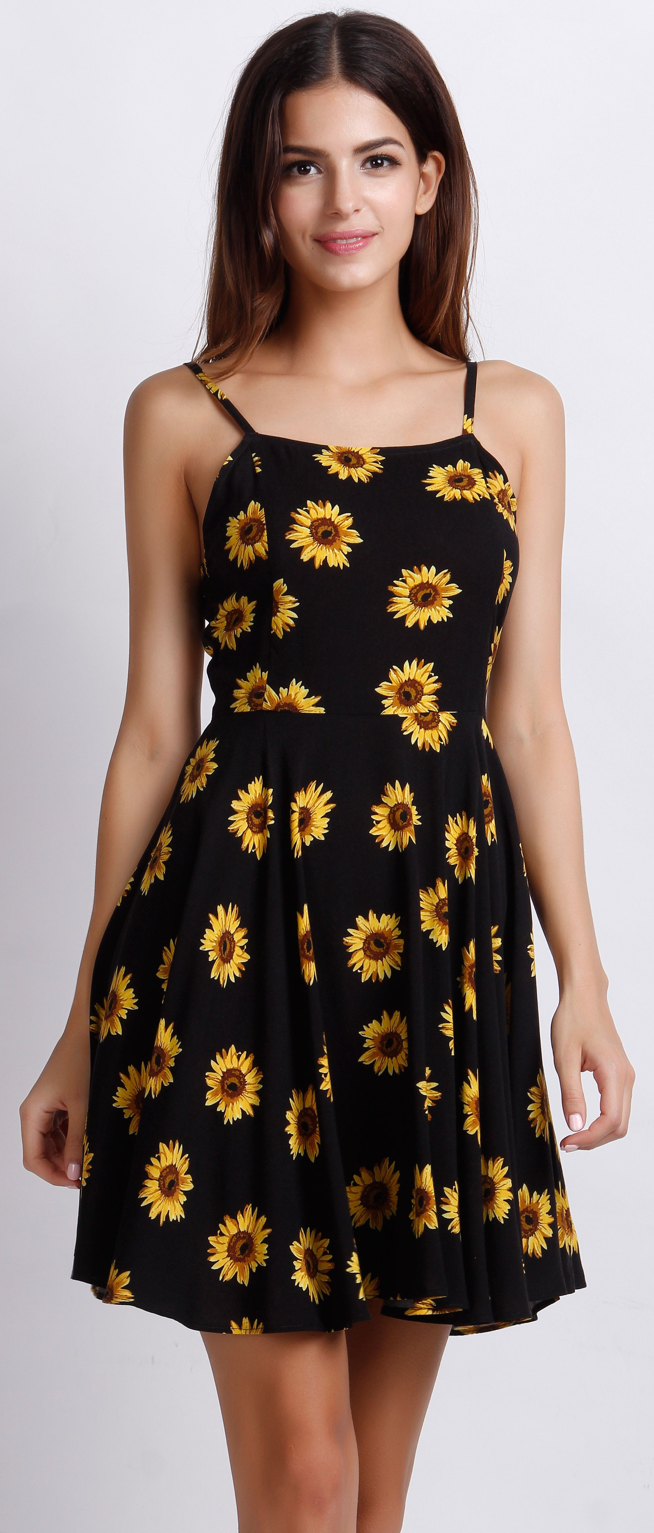 af135b54165 Being cheerful and lively just like the sunflower printed in the dress.  Show your sunny side in this hot summer. Find it at OASAP.