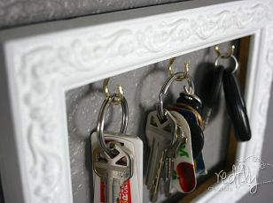 DIY Key Holder out of a dollar store frame. -- totally doing this! Andrew and I need a keyholder by our front door!
