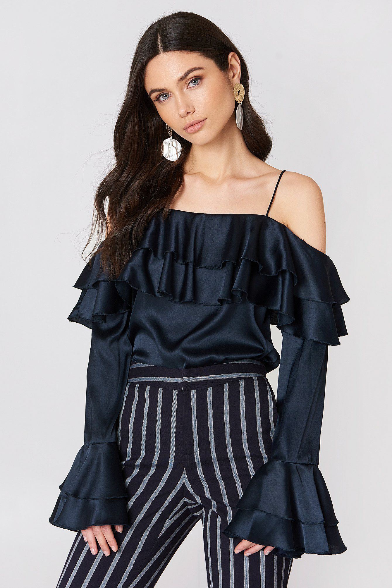 233c2f608a53d The Off Shoulder Double Flounce Top by NA-KD Party features a cold shoulder  design