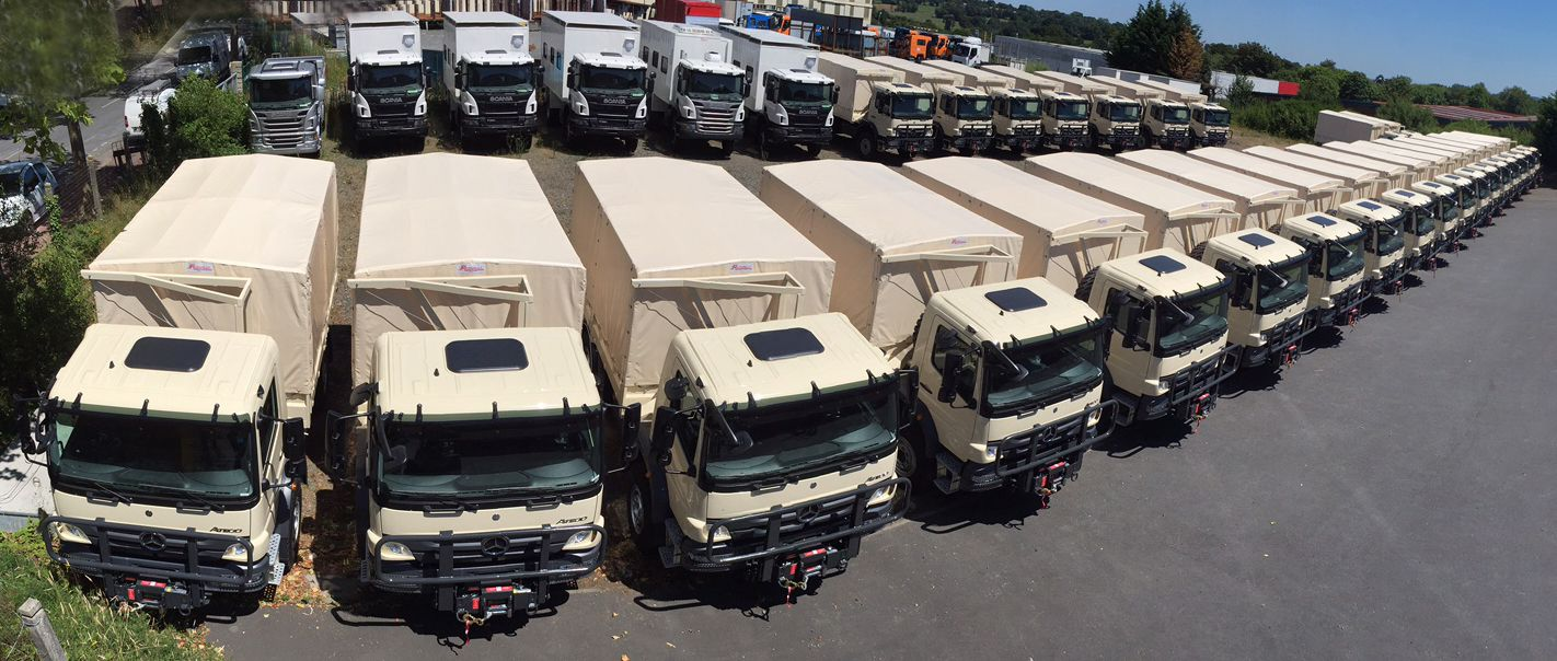 Mercedes Atego 1317A 4x4 trucks standing in line. Looking