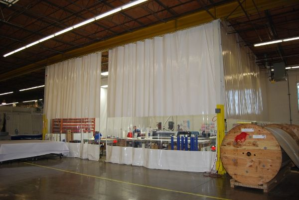 A Retractable Industrial Curtain Enclosure Is Used To Prevent