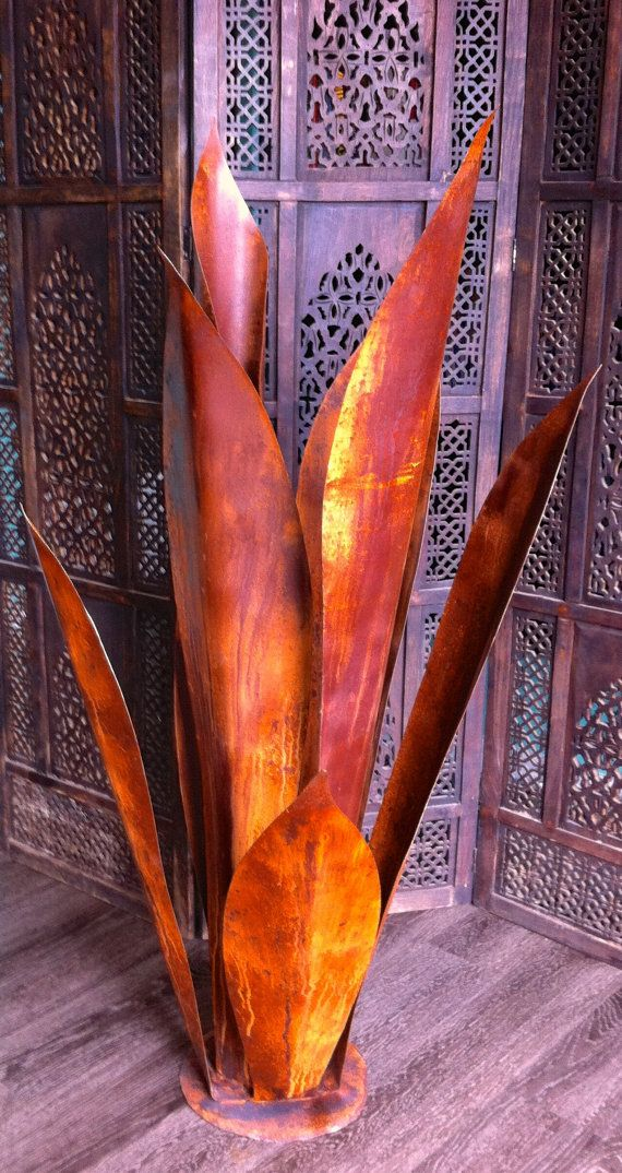This is one of a kind and in charge xl agave. it stands at 4 feet tall and demands attention. Made of solid steel with elegant patina this piece screams presence.These are handmade to order and will vary from piece to piece. Makes the perfect center piece.