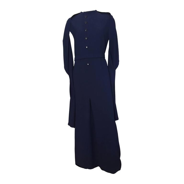 Pauline Trigere 70s navy wool long dress with shawl size 12 / 14.   From a collection of rare vintage evening dresses at https://www.1stdibs.com/fashion/clothing/evening-dresses/ @1stdibscom #PaulineTrigere #vintage #fashion #shopping #luxury