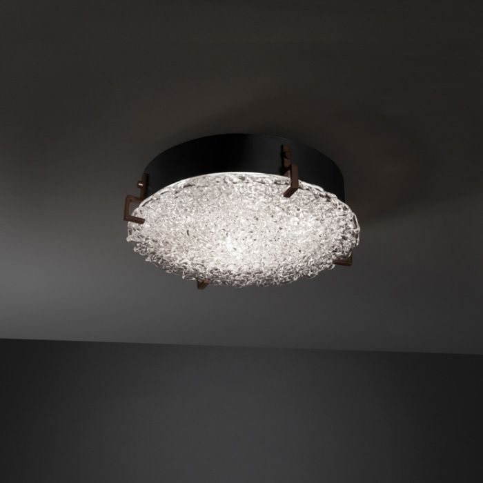 The Clips Round Veneto Luce Wall/Ceiling Light features an elegant Lace glass diffuser with  Dark Matte Black clips and is available in 2 sizes. LED: 39 or 65 watt 120 volt 90CRI, 3000K, 77 lumens per watt LED modules are included. Dimmable down to 5% with low-voltage electronic dimmers. 16.5 & 24.5 inch diameter x 4 inch depth.
