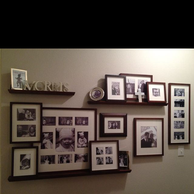 Finally Finished The Wall O Pics So Much Easier Than I Thought To Layer And Secure Frames Instead Of Pricey Ris Photo Arrangement Vintage Family Photos Wall