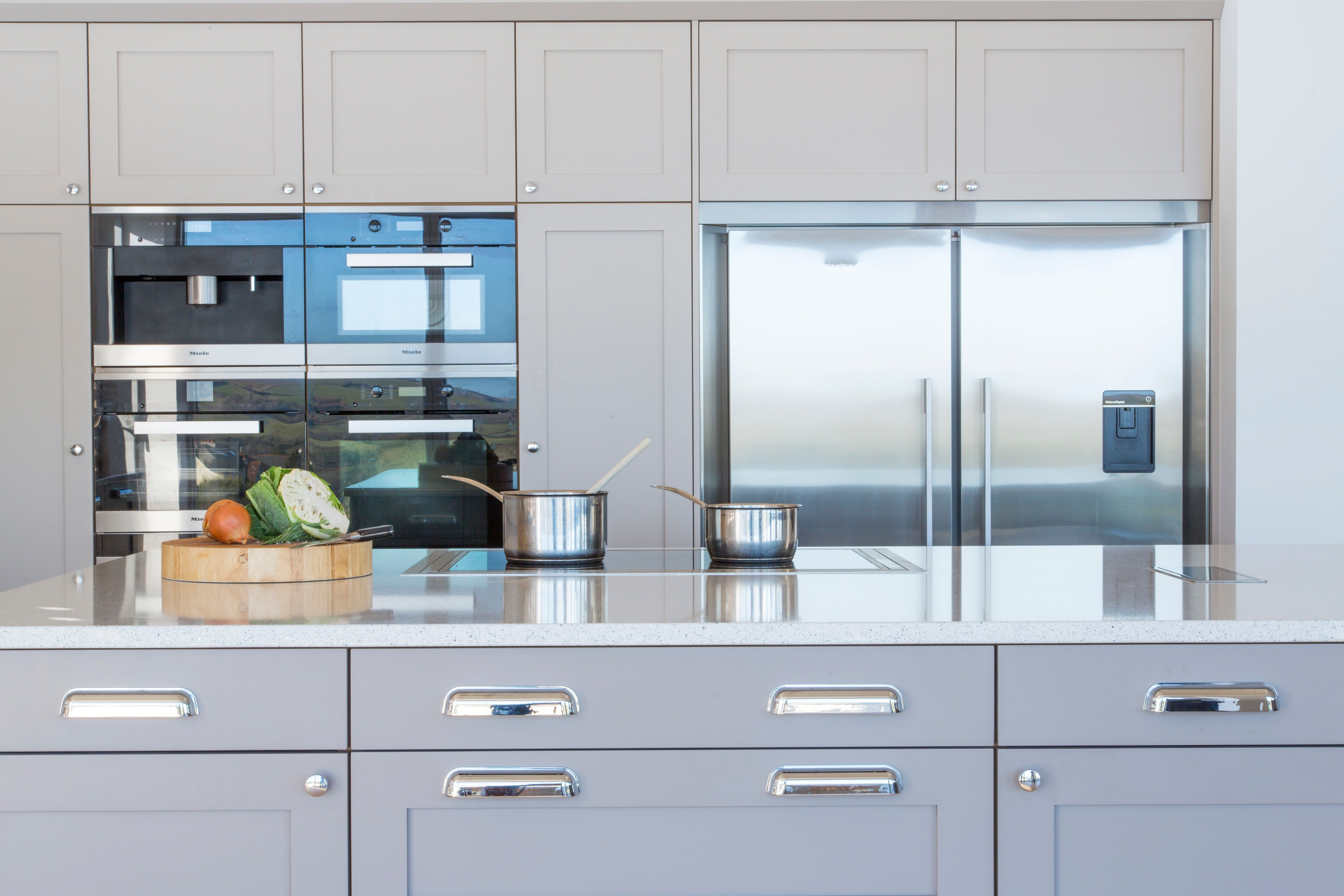 Painted shaker kitchen with Silestone worktops and Miele, Gutmann ...