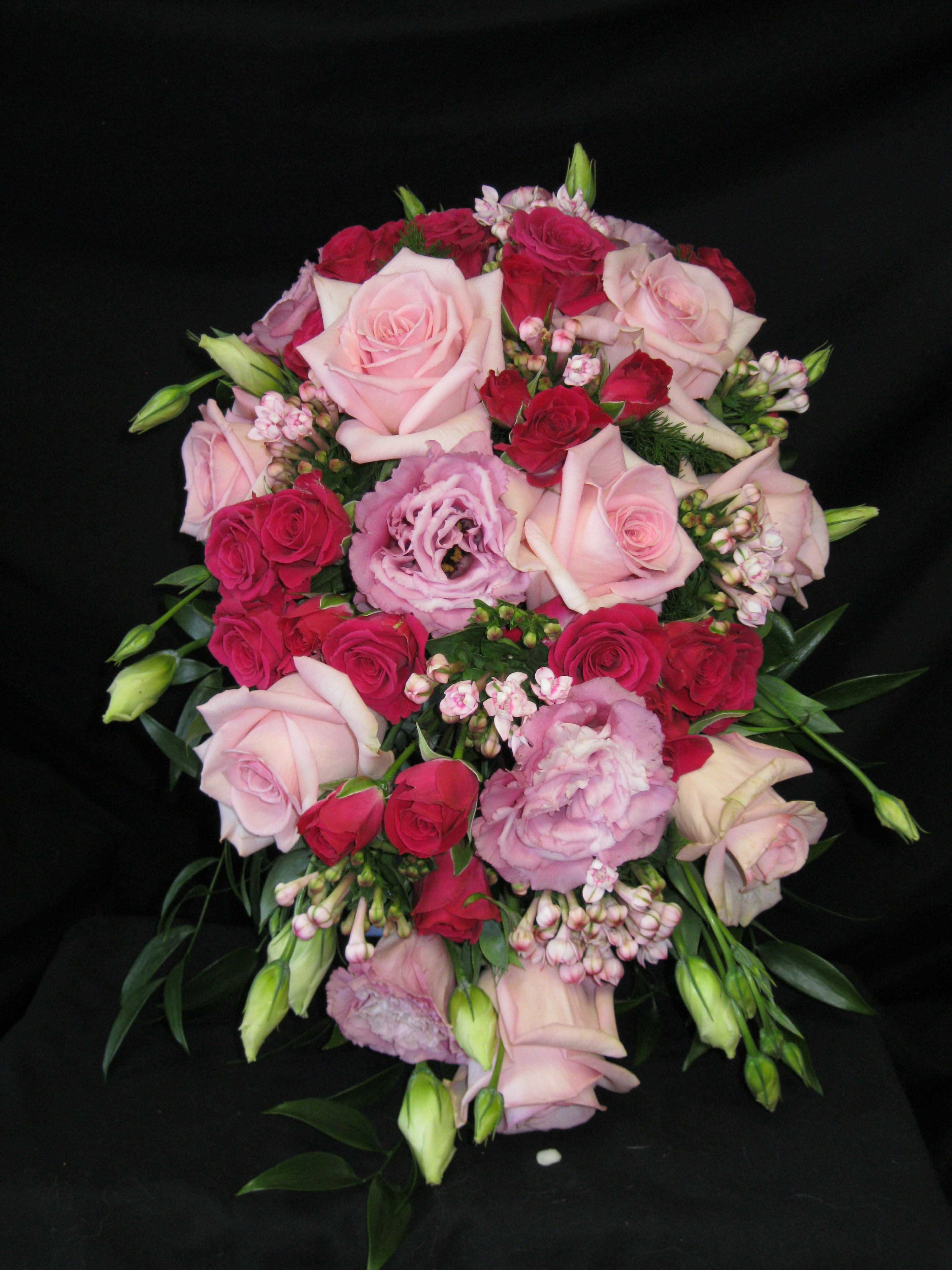 Cascade bouquet created with hot pink spray roses light for Flower sprays for weddings