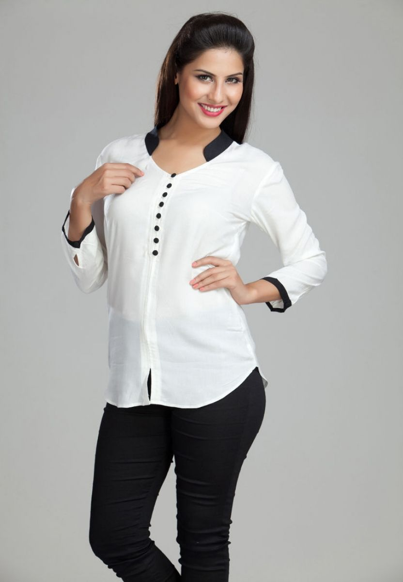 White coloured shirt for women. Crafted from modal this hip length ...