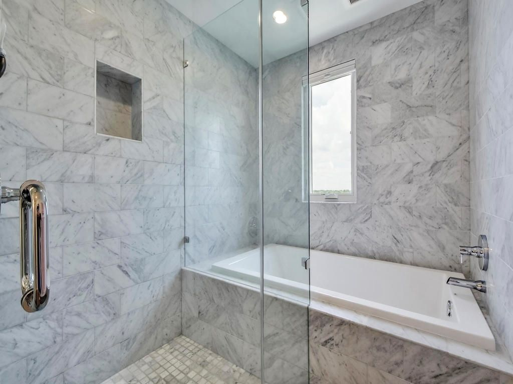 The floor to ceiling carrera marble in the bathing area provides and ...