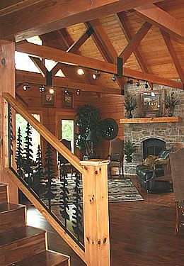 Reddish Brown Heavy Timber Great Room Stone Fireplace