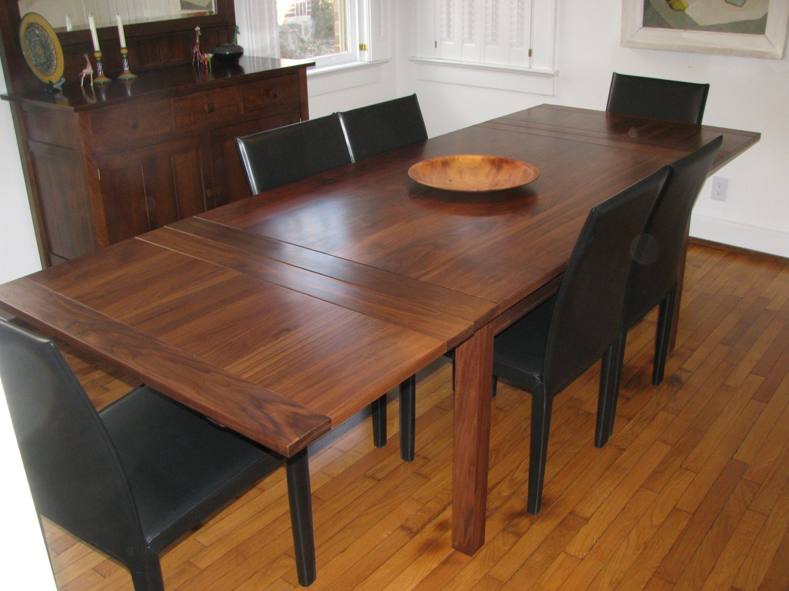 Solid Walnut Dining Table With Self Storing Leaves Shown In Open