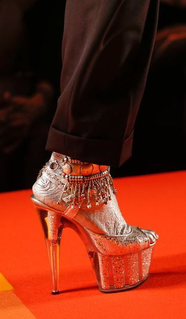 Jean Paul Gaultier...horrible idea about matching the foot..takes away from the shoe
