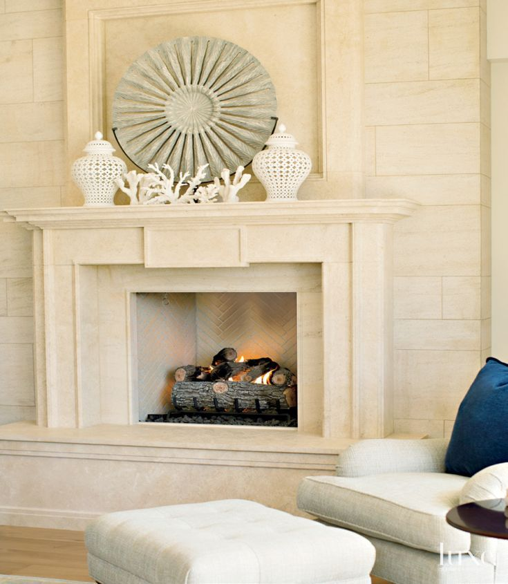 A limestone fireplace accents a corner of