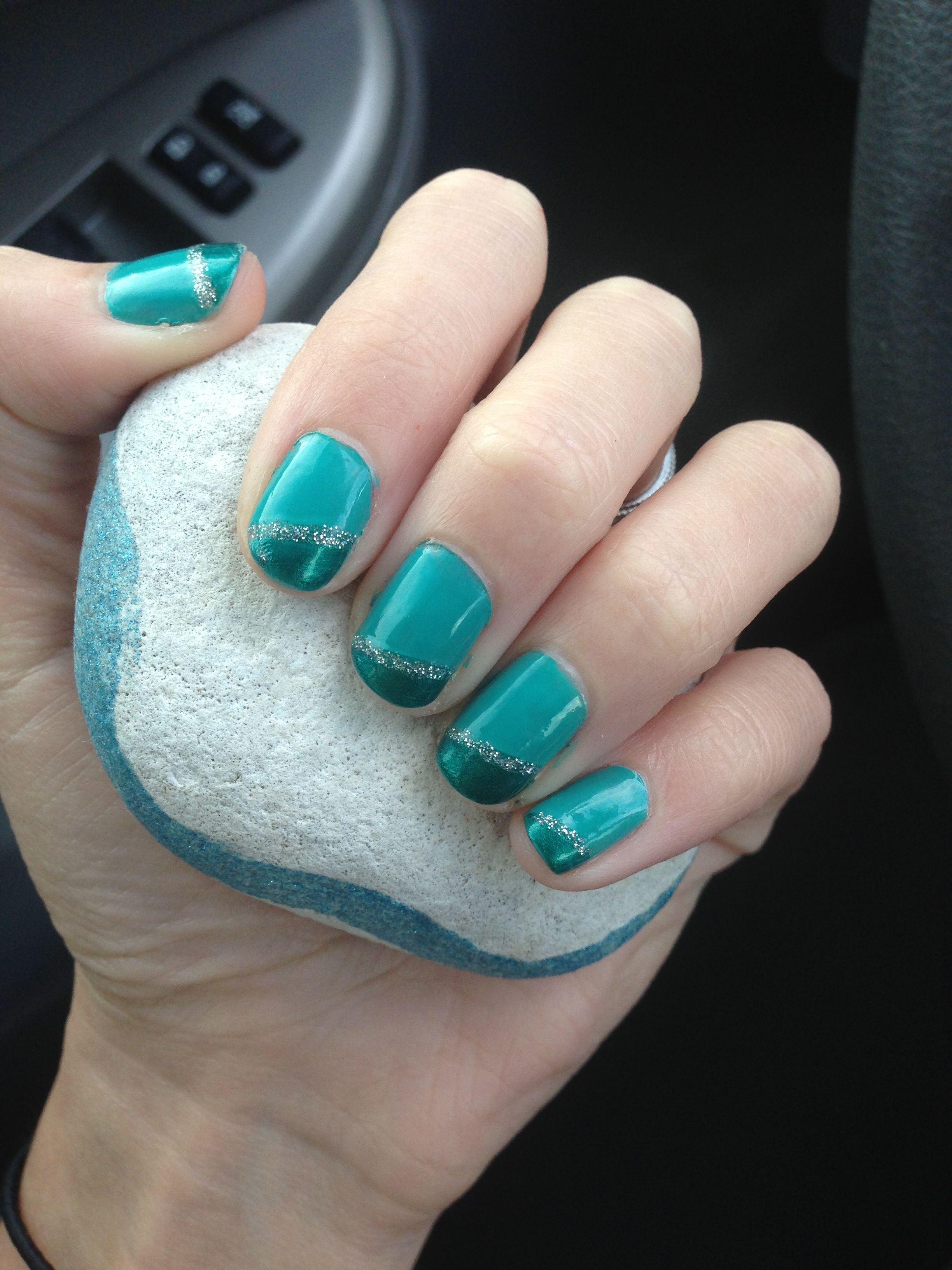 Teal And Aqua Slanted French Nail Design With Silver Sparkles