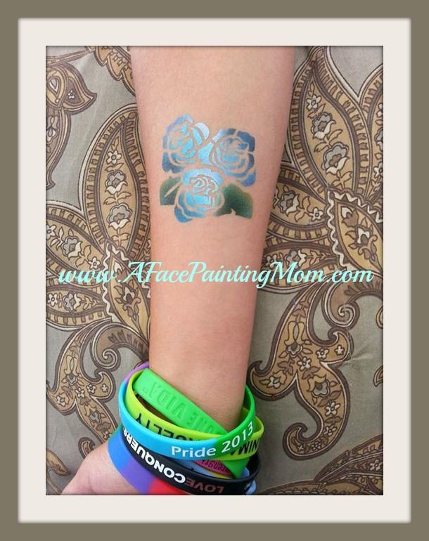 GREAT airbrush tattoo!  Have a glitter or Airbrush artist at your next event and watch the magic happen! Let us Entertain you!