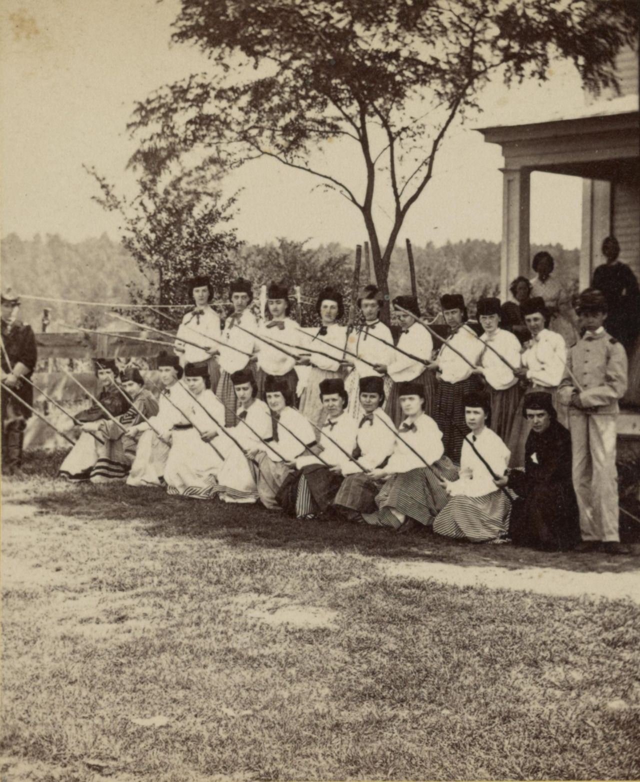 866425b96b8 Women of the White Mountain Ranger Home Guard pose with sharpened sticks