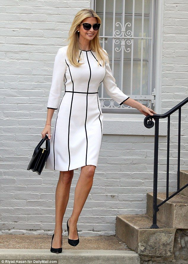 Extras: Ivanka accessorized with plain black pumps and a small black  handbag with the white