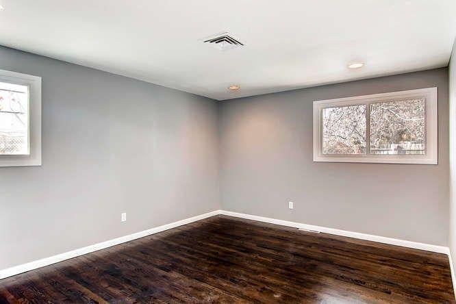 light grey walls gray walls dark hardwood dark wood floors baseboard